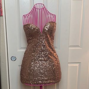 Deep cut sweetheart sequin dress.